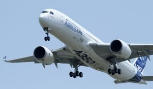 "The new Airbus A350 flies over Toulouse-Blagnac airport during its maiden flight in southwestern France, June 14, 2013. At almost $1 million a square metre, big jets are the world's most expensive real estate, surpassing London's ""Billionaire's Row."" Little wonder then, that a row over elbow space is sharpening the latest contest between Airbus and Boeing.  Picture taken June 14, 2013    REUTERS/Jean-Philippe Arles/File (FRANCE - Tags: TRANSPORT BUSINESS)"